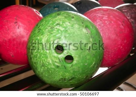 Bowling balls red green closeup row detail - stock photo