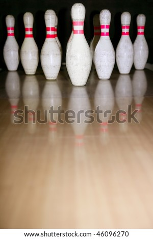 Bowling bolus row reflexion on wooden parquet floor - stock photo