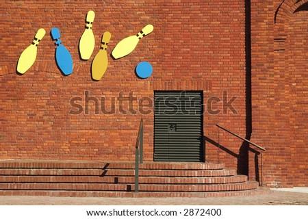 bowling club. brick wall - stock photo