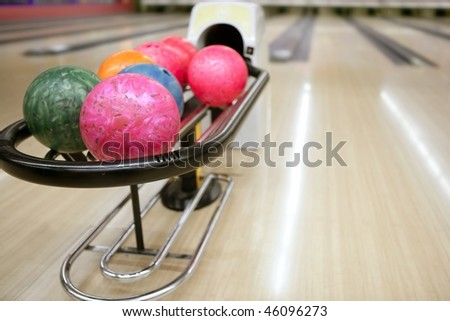 Bowling colorful balls and wooden floor perspective - stock photo