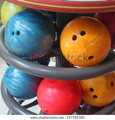 bowling games, bowling ball, Colorful bowling balls in front of the tenpin alley with shoes background, sport competition.  - stock photo