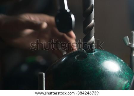 Bowling maker reaming bowling hole - stock photo
