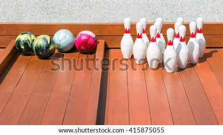 Bowling outdoor sport, wooden bowling lanes. - stock photo