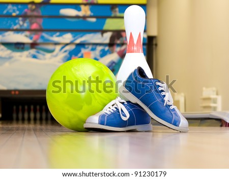 Bowling pins, shoes and ball - stock photo