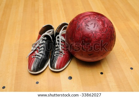 Bowling shoes and ball on the lane - stock photo