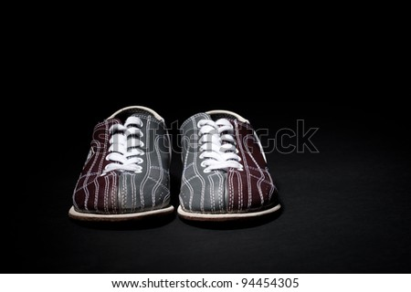 Bowling shoes on a black background