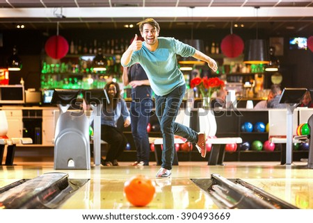 Bowling with a couple of friends in a bowling alley is good fun, and a great idea for a night out - stock photo
