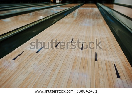 Bowling wooden floor with lane  - stock photo