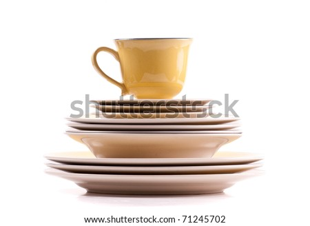 Bowls and Plates Stack with Cup on Top - stock photo