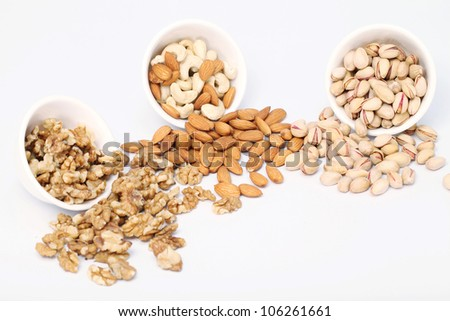 Bowls of Almond,pistachios and wall nuts isolated on white background - stock photo