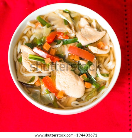 Bowls of Asian soup noodles and vegetables  - stock photo