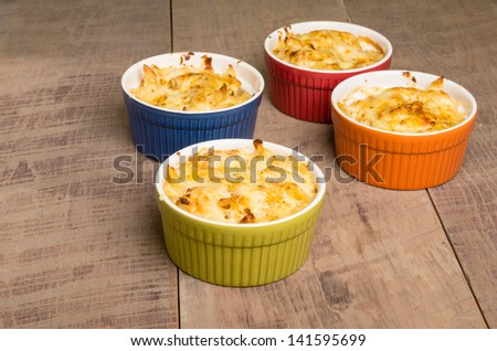 Bowls of baked Dungeness Crab macaroni and cheese