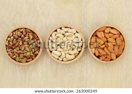 Bowls of cashew,almond and pistachios - stock photo