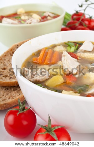 bowls of chicken and vegetable soup