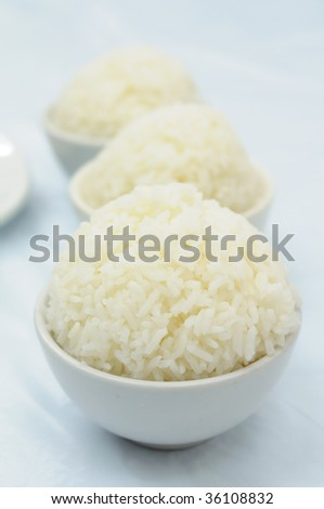 Bowls of cooked chinese rice with shallow DOF - stock photo