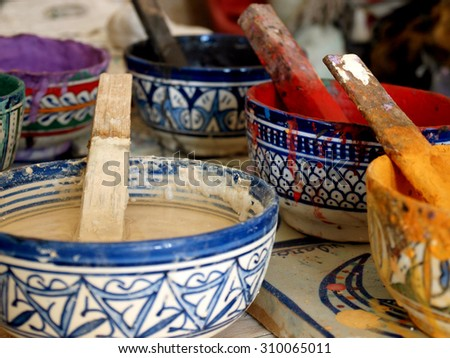 Bowls of different colored paints, Morocco - stock photo