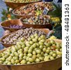 Bowls of olives for sale at a market - stock photo