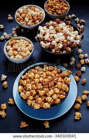 Bowls of popcorn from above, close-up. Sweet popcorn. Salty Popcorn. Pop corn. Popcorn. Popcorn. - stock photo