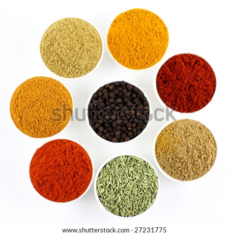 bowls of spices on white background - stock photo