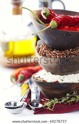 Bowls of uncooked rice over white - stock photo