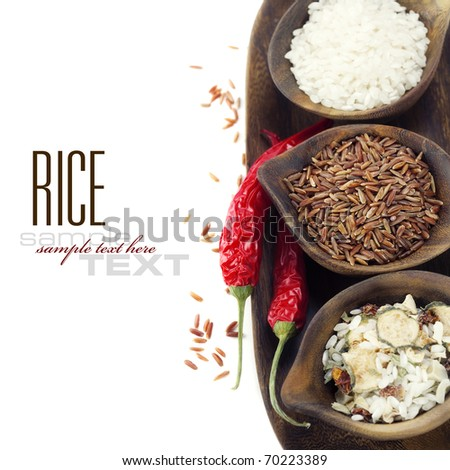 Bowls of uncooked rice over white with sample text - stock photo