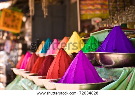 Bowls of vibrant colored dyes in India - holi colors. - stock photo