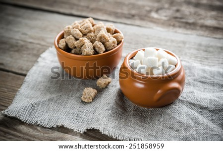Bowls of white and brown sugar - stock photo