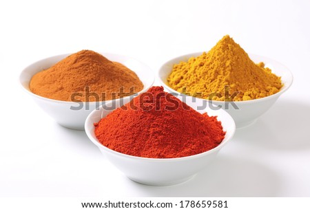 bowls with colorful spices piles - stock photo