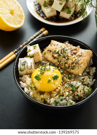 Bowls with jasmine rice, raw egg, sturgeon and vegetables. Shallow dof. - stock photo
