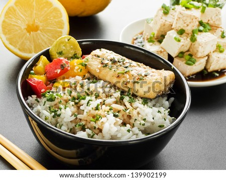 Bowls with jasmine rice, sturgeon and vegetables. Shallow dof. - stock photo