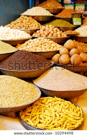 bowls with spices and nuts at indian market - stock photo