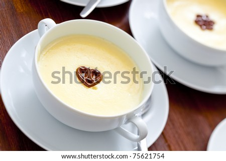 bowls with sweet vanilla pudding - stock photo