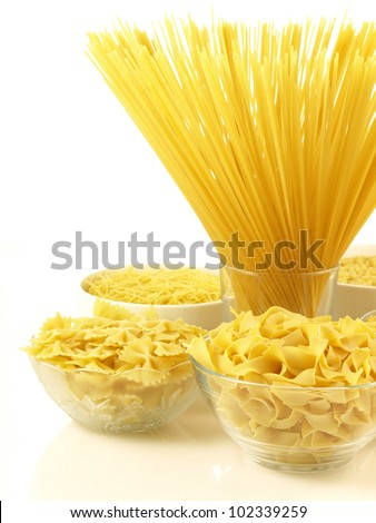 Bowls with various kind of raw pasta