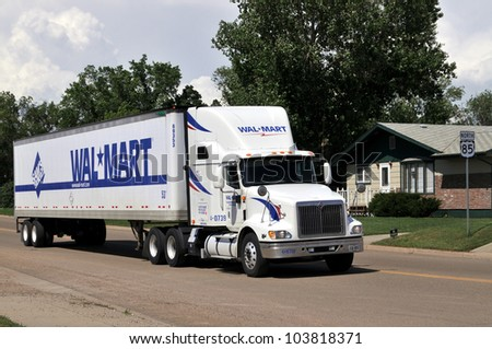 BOWMAN-JUNE 18:Wal-Mart truck driving through Bowman, North Dakota, on June 18, 2009. The recession has brought wealthier customers to Wal-Mart looking for bargains, the AP reports. - stock photo