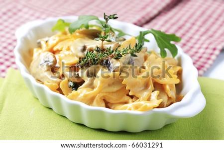 Bowtie pasta with mushrooms and cream - stock photo