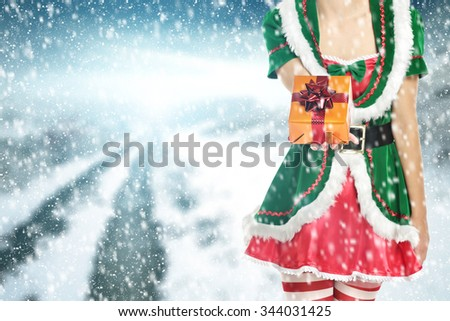 box and ribbon and woman in green dress and sun light  - stock photo