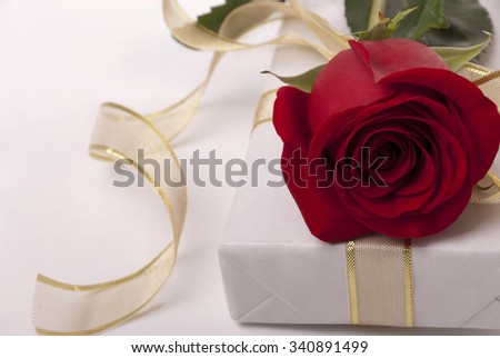 Box and rose - stock photo