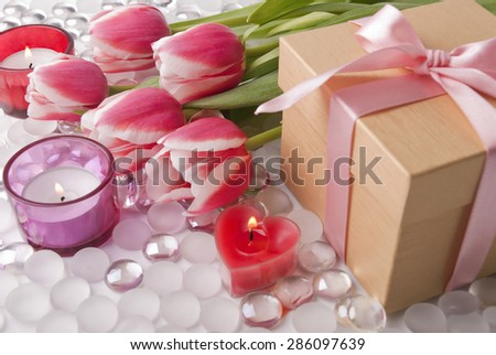 Box,candles and tulips - stock photo
