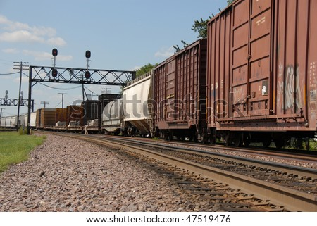box cars and tanker on tracks - stock photo