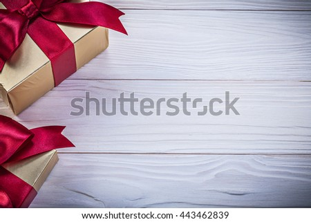 Box-containers with presents on wooden board copy space holidays concept. - stock photo
