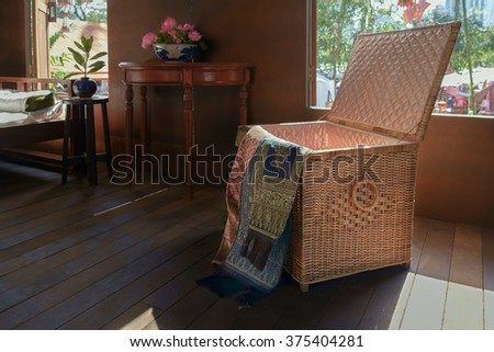 Box fabric crafts made of wicker in ancient thai style house.