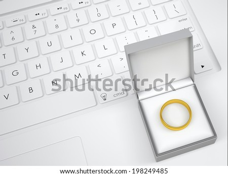 Box for jewelry with gold ring on the keyboard. View from above - stock photo