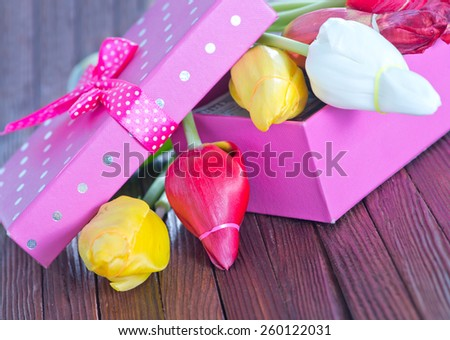 box for present and tulips - stock photo