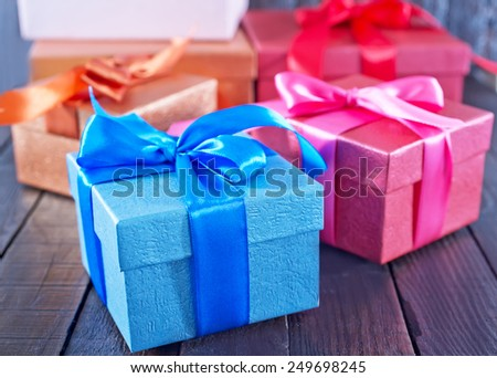 box for present on the wooden table - stock photo
