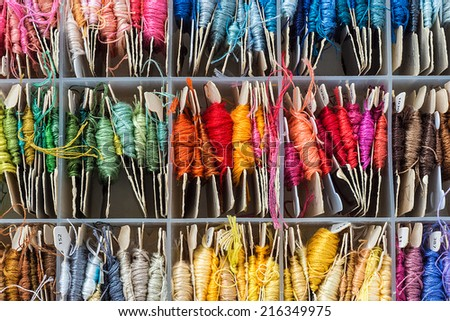 box full of skeins of embroidery - stock photo
