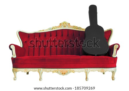 Box guitar on vintage luxury armchair isolated on white background with clipping path.