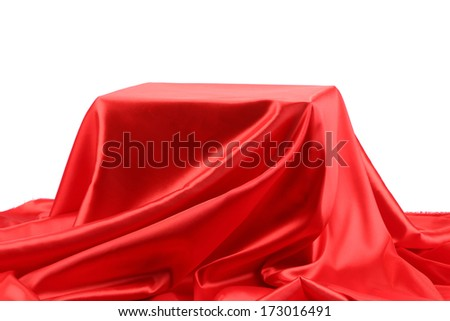Box in red silk fabric background. Whole background.