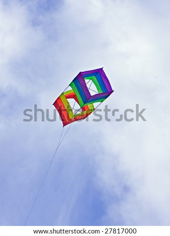 box kite shot against deep blue sky - stock photo