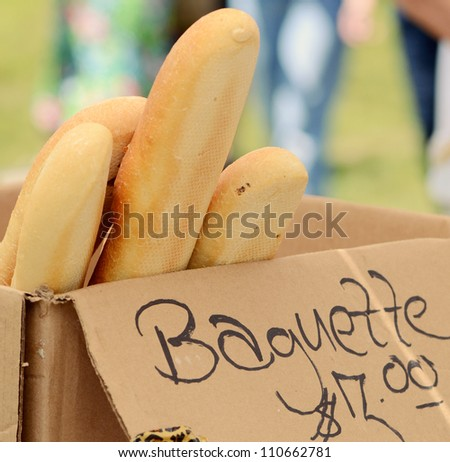 Box of baguettes for sale at a Farmers' Market
