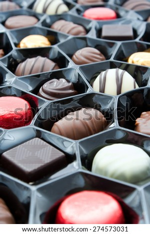Box of chocolates at an angled overhead view with a shallow depth of field - stock photo